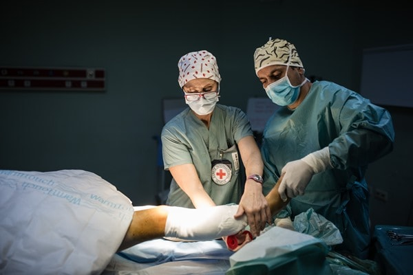 OT nurse Dianne Hyra-Kuzenko from Canada puts a bandage on the operated wound