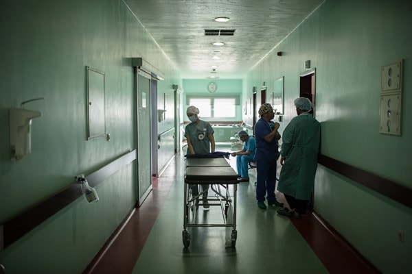 ICRC's surgical team takes a break after an operation and prepares for the next one.