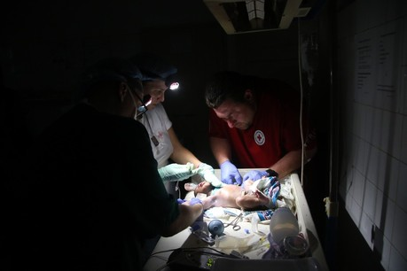 A power outage means medical care needed to be delivered in the dark in Mozambique