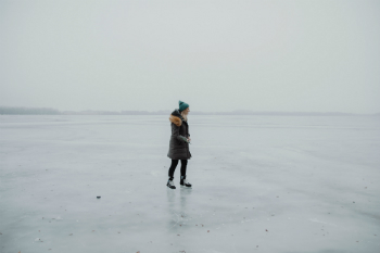 women skating on frozen lake
