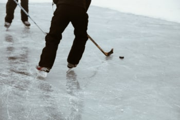 playing hockey on frozen ice