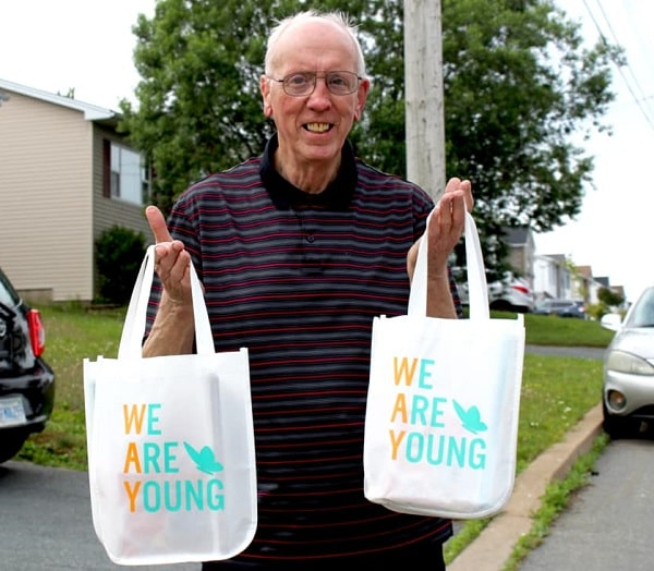 Colin McCrae volunteers at We Are Young, a Nova Scotia-based non-profit that is using funds received from the Red Cross to reach out to more seniors who may be feeling isolated during COVID-19. Here, Colin prepares to deliver a couple of self-care gift bags to seniors in need. The Government of Canada provided the funds through its Emergency Community Support Fund granting program.