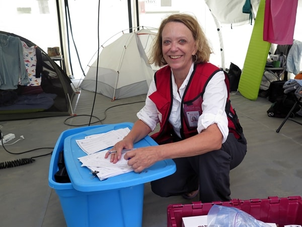 Canadian Red Cross Doctor Patricia Connick getting medication ready to go out on a mobile clinic