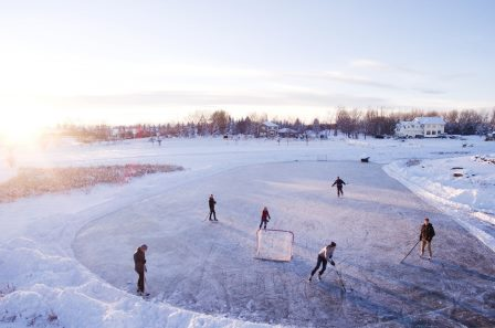People skate on a pond