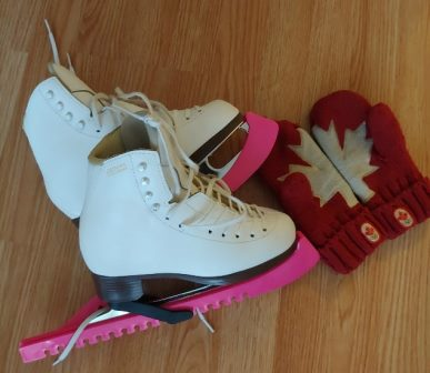 A pair of skates with a pair of mitts