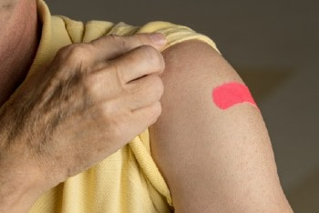Photo of person with Band-Aid on arm