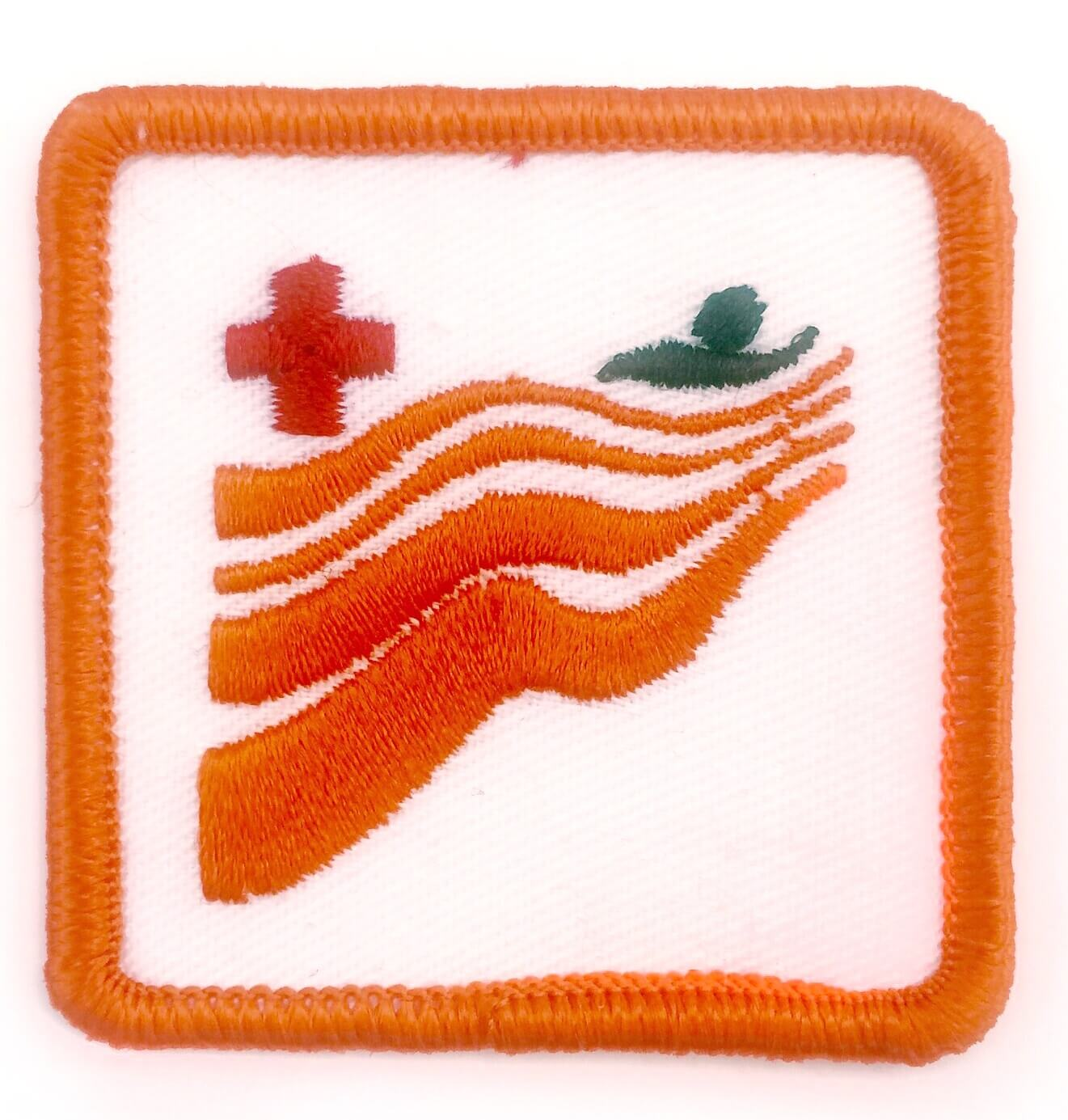 Red Cross Swimming Badge – Level Orange