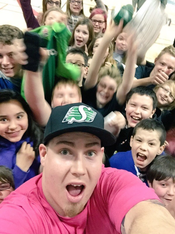 Dan Clark poses for selfie with kids