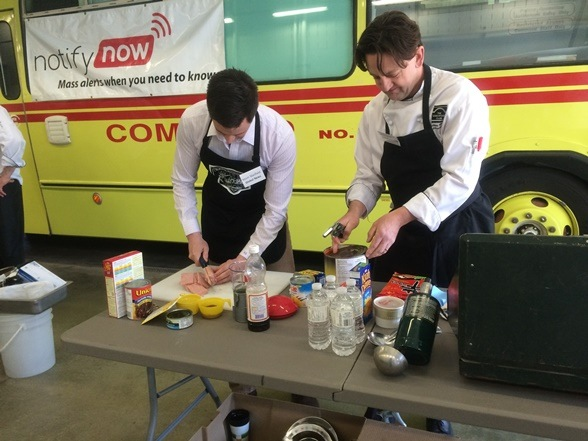 Kevin and Chef Anthony preparing their food