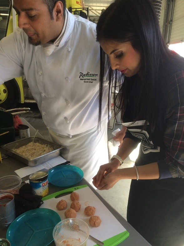 Maleeha forms Croquettes while Chef Manpreet stirs food