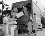 Archival image of Red Cross corps loading supply truck