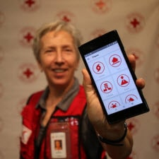 Red Cross Volunteer displaying smartphone with BeReady app