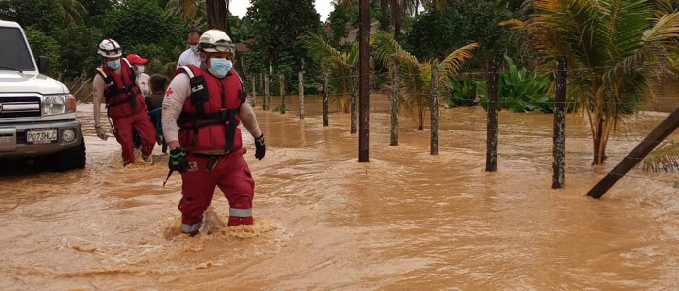 A group of Rescue workers are knee-deep in hurricane drenched streets.