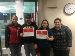 Red Cross staff Cailin Hodder and Annie Papadakis (far left and far right) present 5 year milestone awards to Red Cross volunteers Jae Redfern and Madeleine Redfern