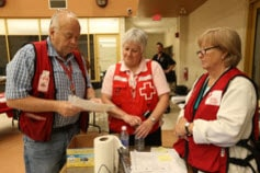 three Red Cross workers