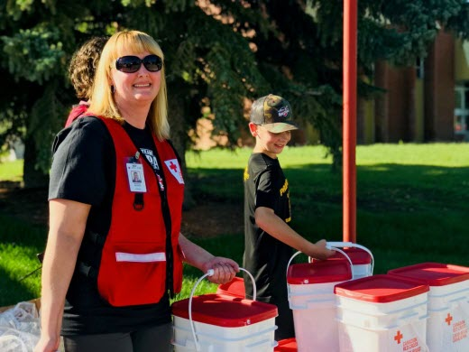 Red Cross staff member Shannon Halpenny delivers clean up kits