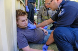 First responder assists injured male