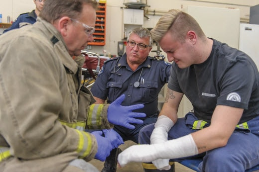 first responders treat arm injury