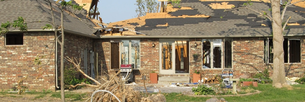 A house that has been damaged by a tornado