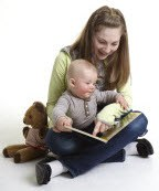babysitter and baby reading together