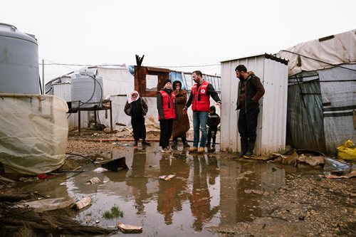 Red Cross workers in flooded area
