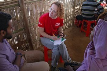 Sherry Humphrey, a registered nurse, sits next to her translator on a short red stool as the pair works out why Halima came to the clinic.