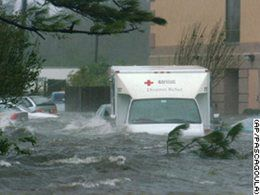 Red Cross truck navigating flooded street during Hurricane Katrina
