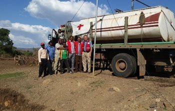 People were coming from four to five kilometers away filling up bright plastic water containers with the fresh clean water provided by the Red Cross water truck.