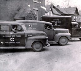 Archival image of Red Cross blood transfusion service vehicles