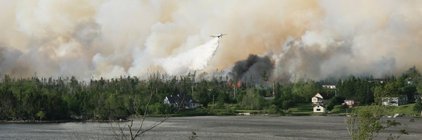 A large wild fire in a heavily forested community