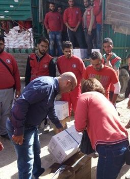 Distributing aid to those still in the besieged city