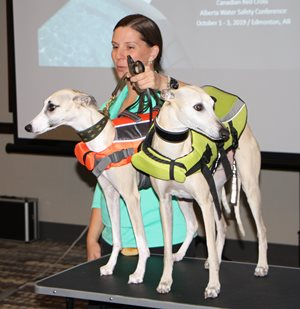 Christine with two dogs in lifejackets