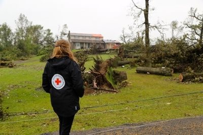 Red cross worker in area damaged by tornado