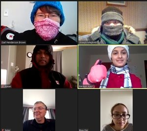 A zoom meeting with newcomers, dressed in winter gear
