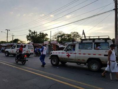 Red Cross vehicles on a street
