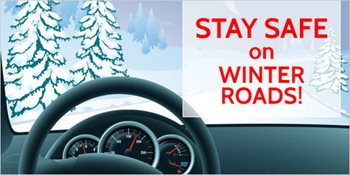 Behind a steering wheel on a snowy day. Text reads stay safe on winter roads.