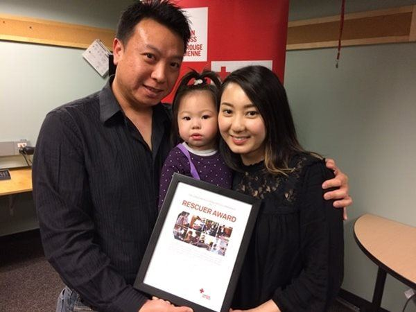 The Canadian Red Cross presented Yanie Choi with a Rescuer Award for saving her choking daughter's life.
