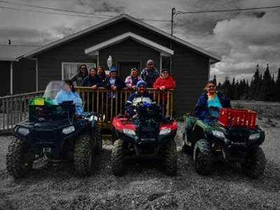 Gathering Place participants with four wheelers