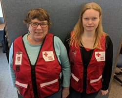 Canadian Red Cross volunteers Carolyn Wanamaker (left) and Tonya Bradley (right) were on site to help Treena after the fire.
