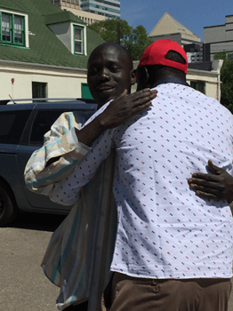 Marial Mayom Riak and his uncle Anyuon Awan meet each other with smiles and hugs