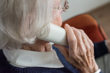 A senior speaks on the phone